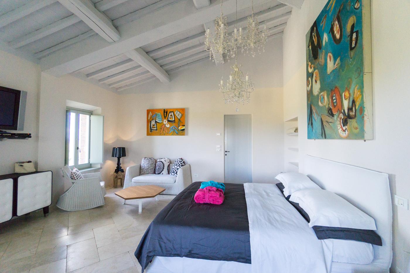 Chambre à coucher de l'hôtel boutique SIena House